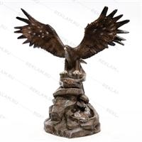 рекламная фигура орел на камне