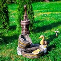 декоративный фонтан с утками